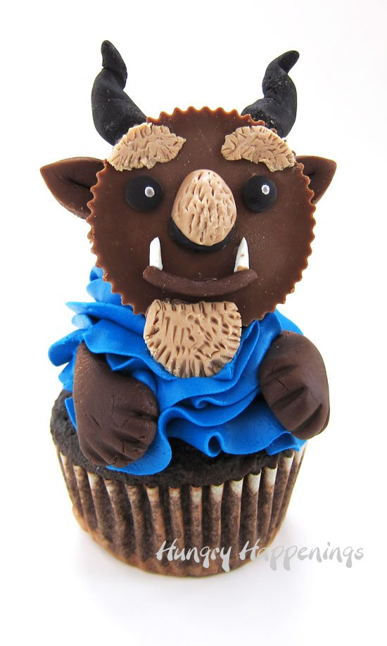Beast Cupcakes inspired by Beauty and the Beast Emoji are made with Reese's Cups decorated with candy clay (modeling chocolate).