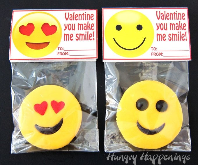 "Your kids will love sharing these homemade 2-ingredient fudge emoji decorated with smiley faces for Valentine's Day. Get the printable ""Valentine You Make Me Smile"" tags at HungryHappenings.com."