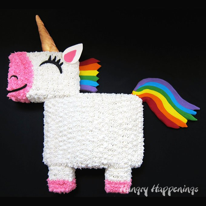 You won't believe how easy it is to transform a 9x13 sheet cake into this delightful Rainbow Unicorn Cake with a colorful candy clay (modeling chocolate) mane and tail.