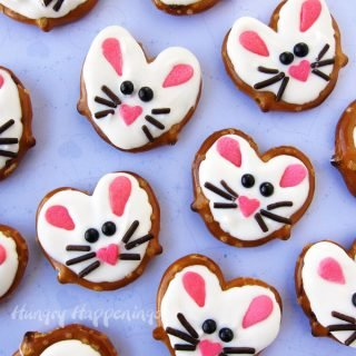 These salty and sweet Easter Bunny Pretzel Twists are so darn cute and easy to make using heart shapes sprinkles, chocolate jimmies, and black candy pearls. These cute treats are perfect basket fillers!