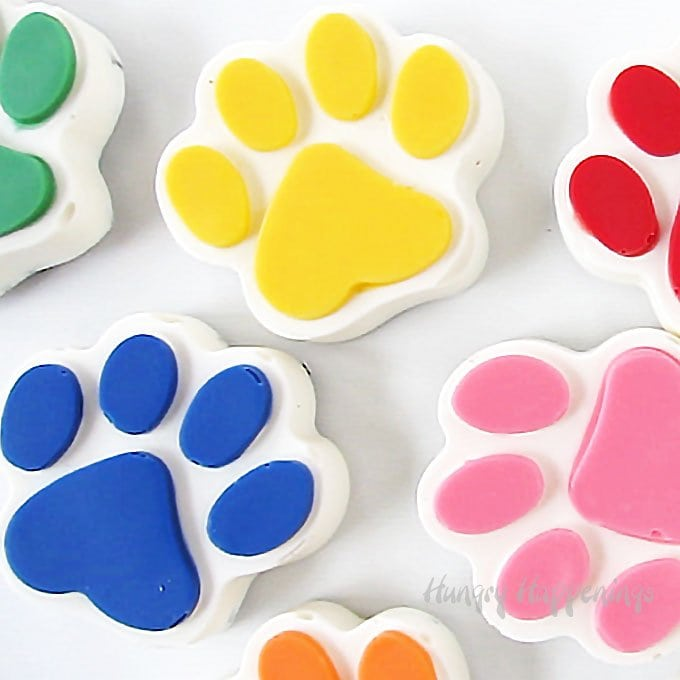 If your kids are in love with Chase, Rubble, Zuma, Rocky, Skye, and Marshall and you are hosting a Paw Patrol party, these Rainbow Paw Patrol Cookies 'n Cream Paws will make the perfect treats or party favors.