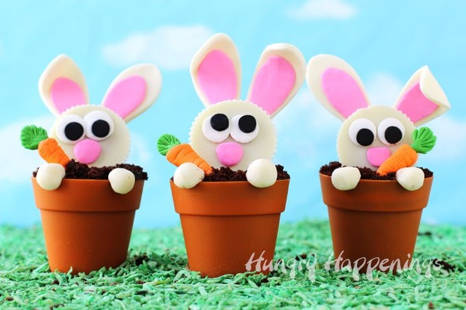 Mischievous little Reese's Cup Bunnies have been digging around in my Terra Cotta Pot Cupcakes looking for candy clay carrots. I can't be mad because these Carrot Thief Cupcakes are just so delightful and will make such darling desserts for Easter.