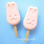 Blend together strawberry yogurt and Cool Whip to make these cute and easy Frozen Yogurt Bunny Pops. Your kids will enjoy these simple-to-make treats for Easter or on a hot summer day.