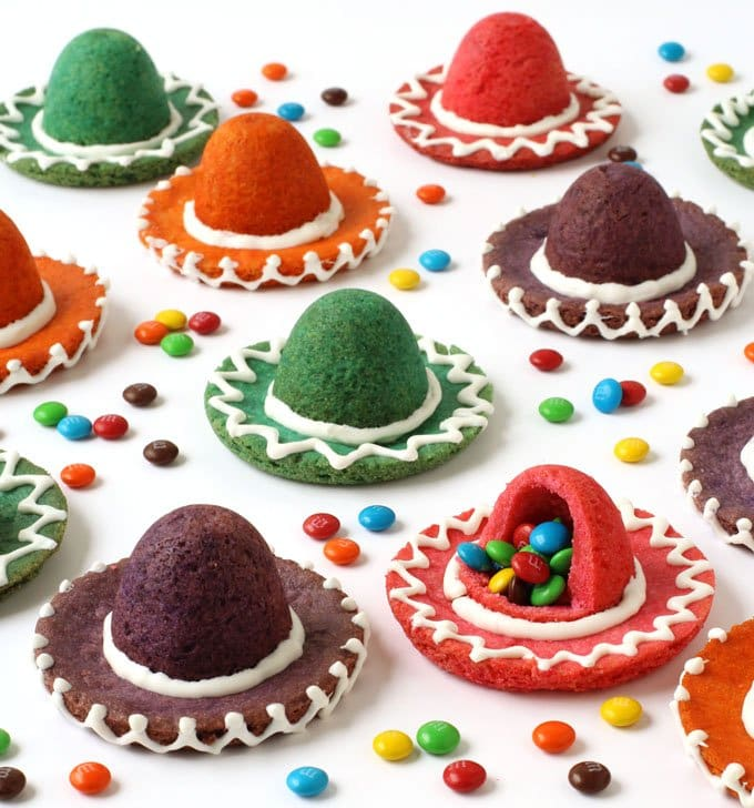 Break open one of these colorful Sombrero Cookies to reveal the surprise inside! These festive candy filled treats will be perfect for Cinco de Mayo or a Fiesta.