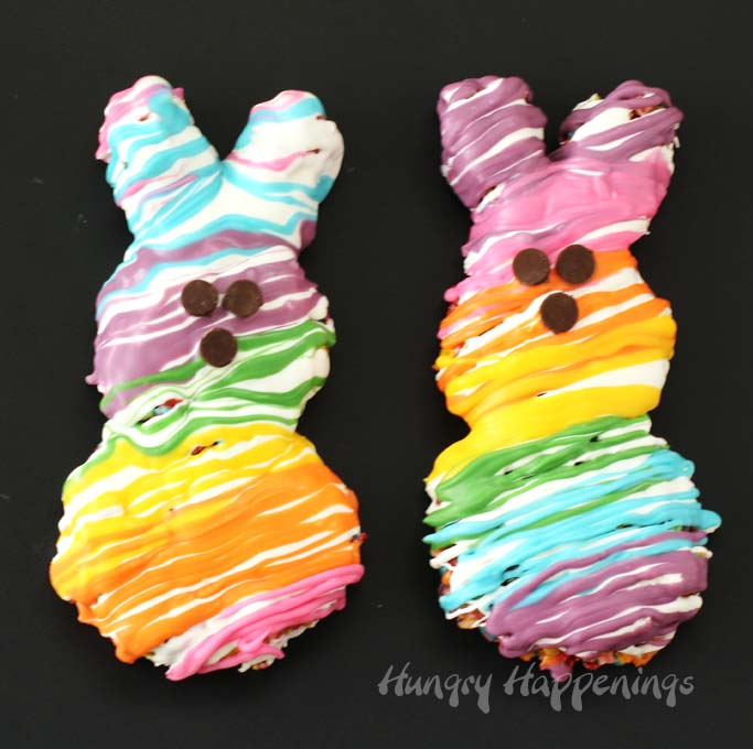 This Easter brighten up your Easter baskets by adding some Rainbow Peeps Cereal Treats. Each bunny shaped Fruity Pebbles Marshmallow Treat is drizzled with a rainbow of colorful Candy Melts to match the stuffed Rainbow Peeps.