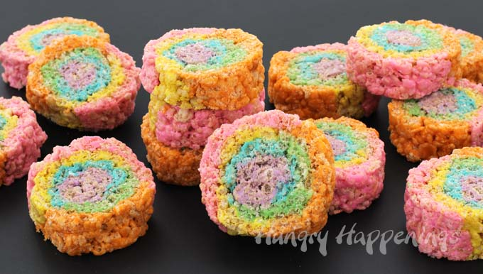 It's so easy to brighten up your cereal treat recipe and to make them more fun. These Rainbow Rice Krispie Treat Pinwheels will be the hit at your next party or holiday celebration.
