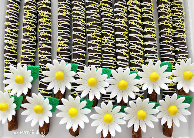 chocolate dipped pretzels with fondant daisies
