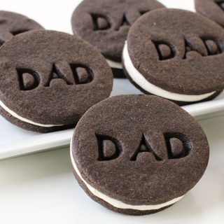 "Father's Day Cookies – Chocolate Sandwich Cookies with Marshmallow Filling Imprinted with ""DAD"""