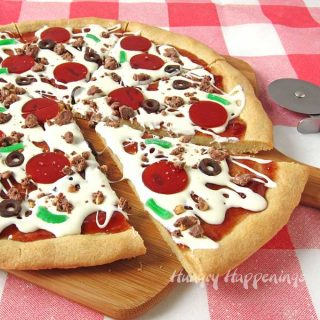 Cookie Pizza Topped with White Chocolate Ganache and Candy