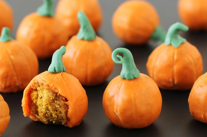 How to make pumpkin doughnut holes for Halloween or Fall.