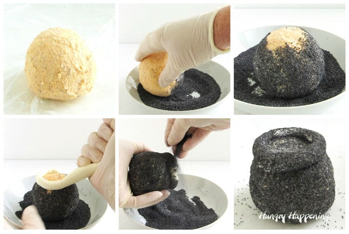 Roll the cheese ball in poppy seeds then pipe a rim around the top of the cheese ball and coat it in poppy seeds to create a cauldron.