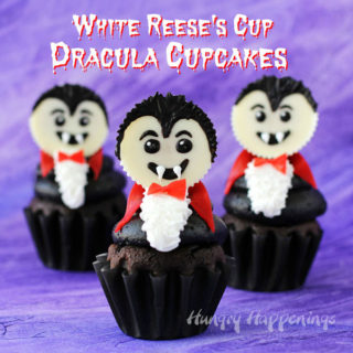 Dracula Cupcakes decorated with White Reese's Cup Vampires. are the perfect dessert for your Halloween party.