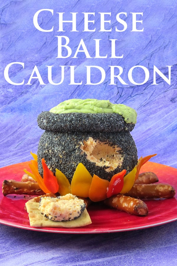 Serve the cheese ball cauldron with crackers for Halloween.