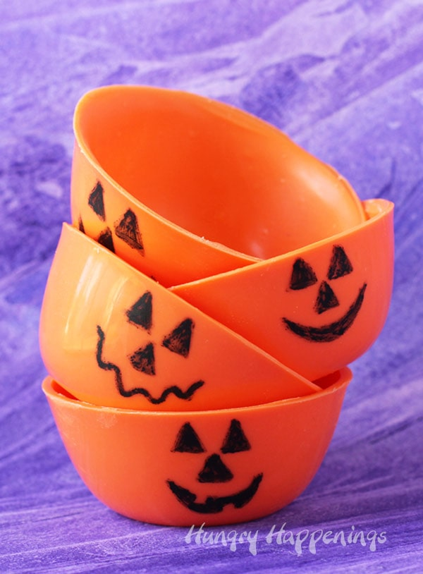 Pumpkin chocolate bowls can be filled with candy or ice cream for Halloween.