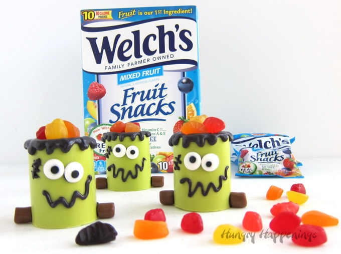Fill Frankenstein Snack Cups with Welch's Fruit Snacks for a fun Halloween treat.