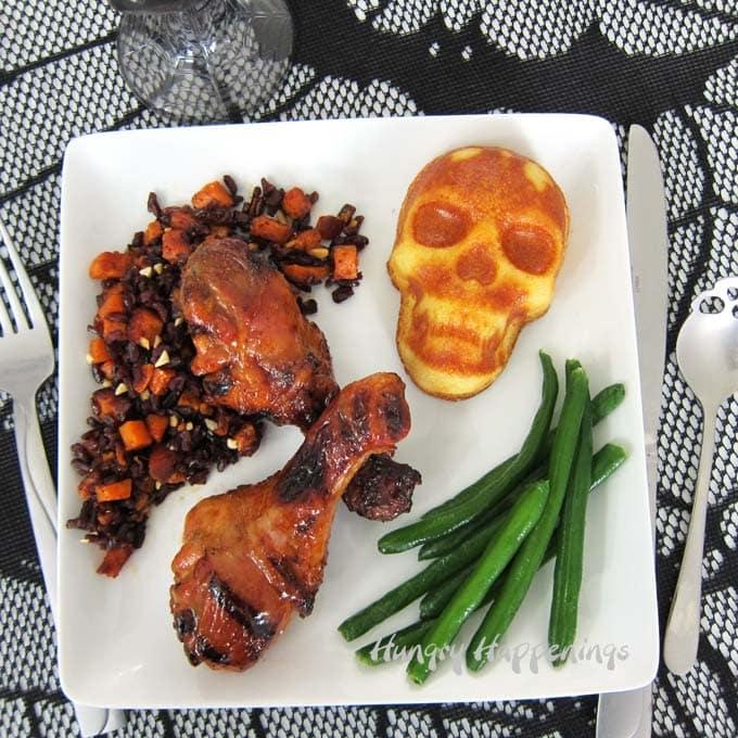 Dark-side Halloween dinner with Wildflower Honey BBQ Drumsticks, Corn Bread Skulls, Sweet Potato Rice, and green beans.