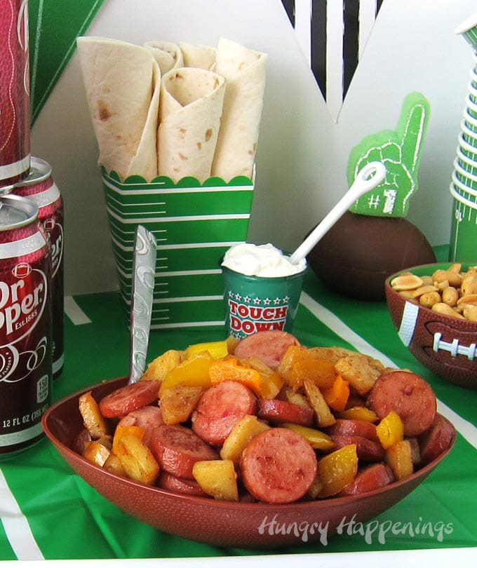 Eckrich Smoked Sausage, potatoes, and peppers served in soft tortillas make great game day food.