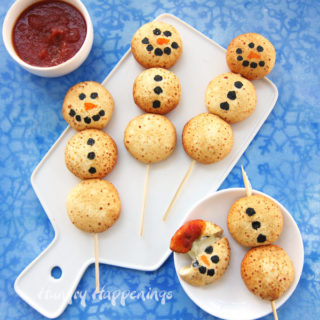 Cheesy Snowman Snacks - Mozzarella Bites Decorated like snowmen for Christmas.