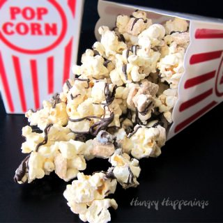 S'mores Popcorn filled with chocolate chips, mini graham crackers, and tiny marshmallows.