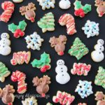 Candy Cane, Rudolph, Snowman, Christmas Tree, Snowflake, Holly Leaves, and Joy Spritz Cookies for Christmas.