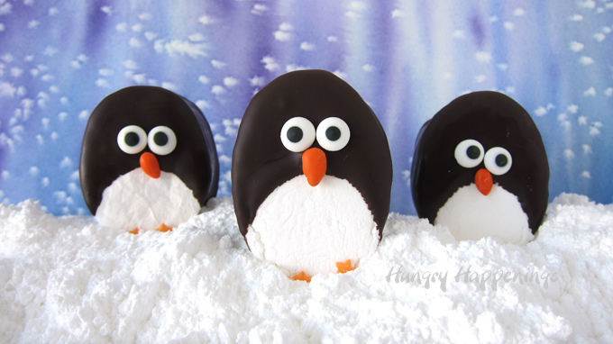 Homemade marshmallows decorated with dark chocolate and candies to look like penguins.