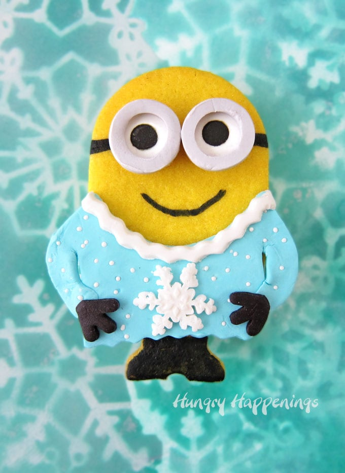Minion Cookies wearing ugly Christmas sweaters are filled with banana candies.