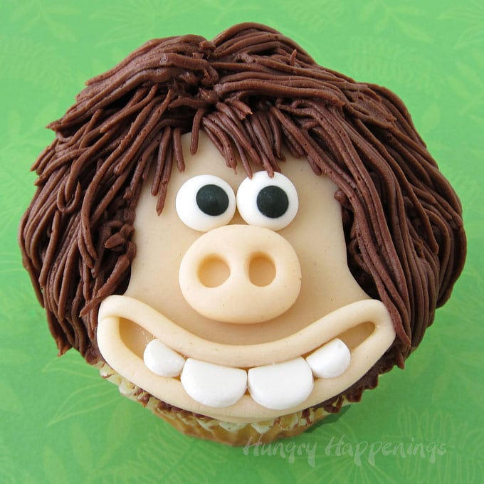 Dug Cupcakes from the Early Man Movie decorated with modeling chocolate (candy clay)
