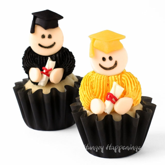 graduation cupcakes decorated with frosting and modeling chocolate