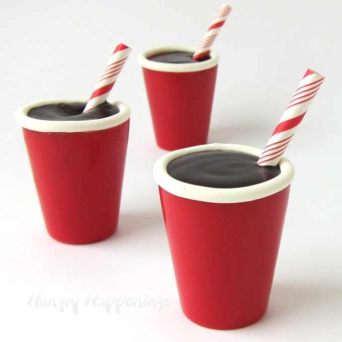 Candy SOLO Cups filled with Coca Cola Chocolate Ganache and decorated with a paper straw make fun desserts for a party.