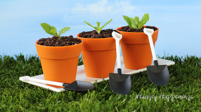 Silicone flower pots filled with chocolate mousse, OREO cookie crumb dirt, and mint leaves.