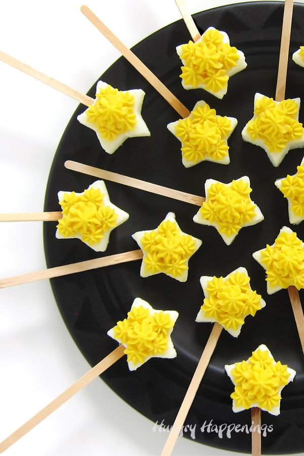 Deviled Egg Star Pops arranged on a platter make a fun snack for any party.