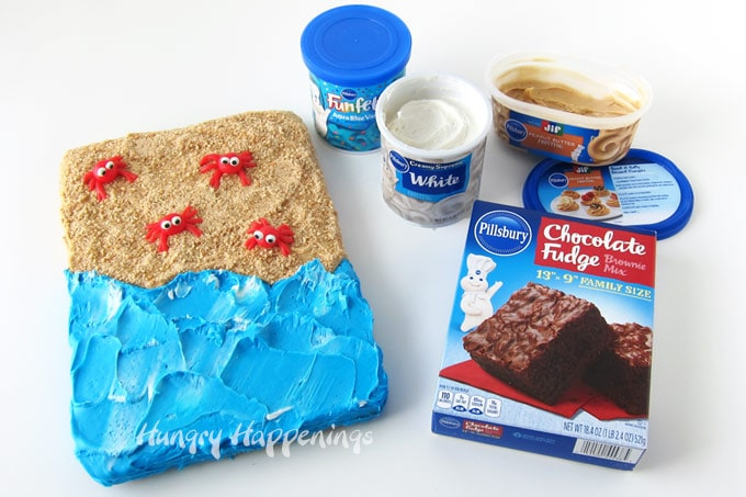 Pillsbury Chocolate Fudge Brownie Mix, Vanilla Frosting, Blue Funfetti Frosting, and Jif Peanut Butter Frosting are used to decorate a beach cake.