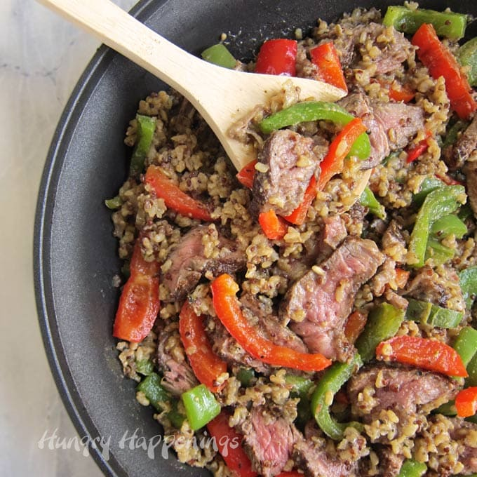 Knorr One Skillet Meals Steak and Peppers with Brown Rice and Quinoa cooked in a skillet.