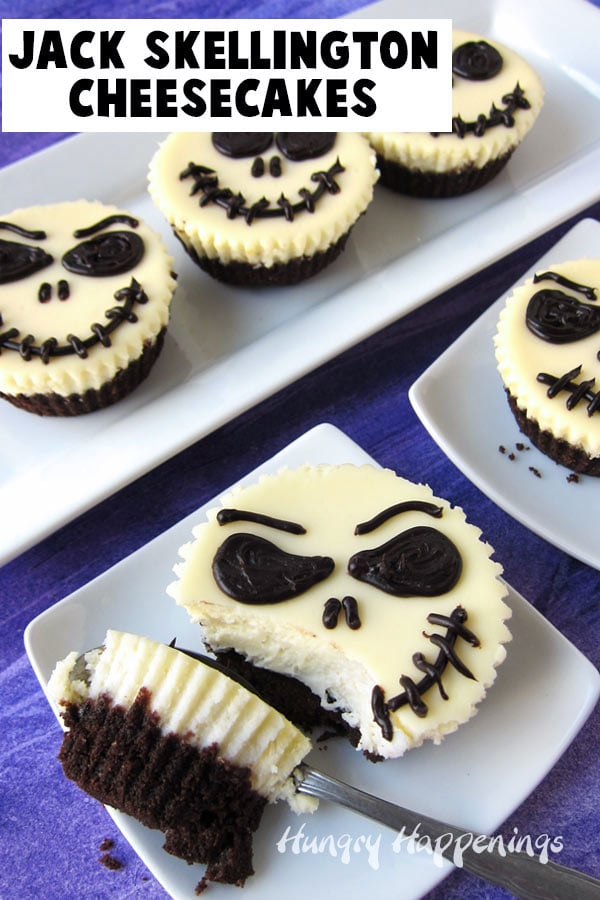 Mini Jack Skellington Cheesecakes serve on white dessert plates sitting on a purple background.