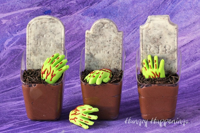 three chocolate mousse graveyards set on a purple watercolor background