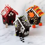 haunted cookie houses made using chocolate cookie dough decorated with bloody bones and skulls, or spider webs and spiders, or candy corn and orange, yellow, and white polka dots