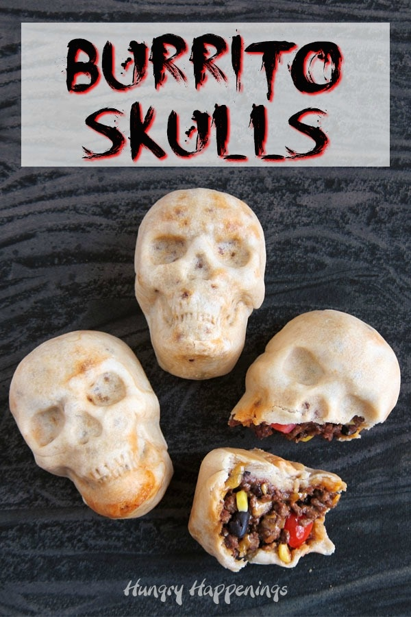 3 burrito skulls with one cracked open showing the taco meat, corn, black, beans, tomatoes, and cheese