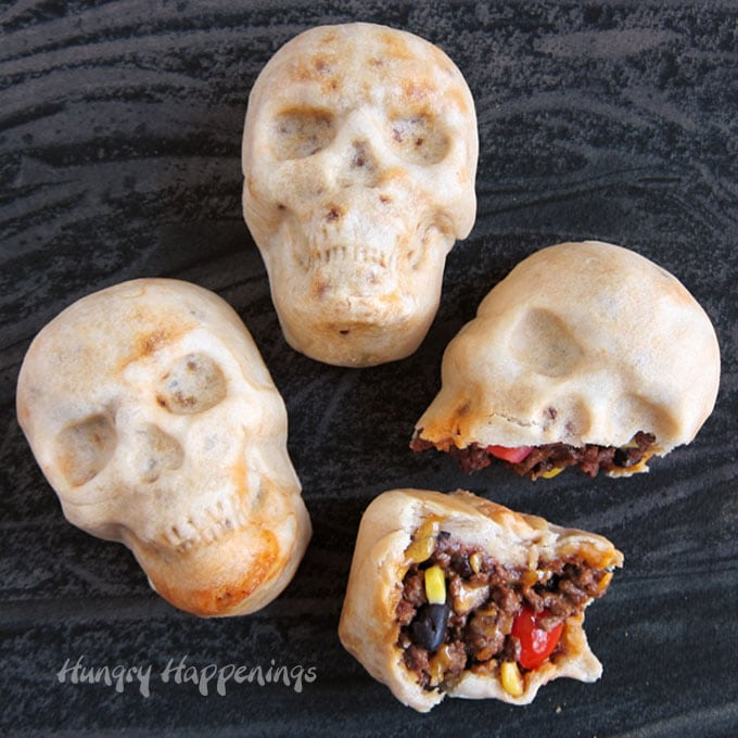 skull shaped burritos filled with taco meat, black beans, corn, tomatoes, and cheese