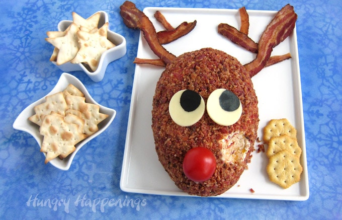 Someone scooped out some of the Rudolph Cheese Ball to enjoy with a snowflake shaped cracker.