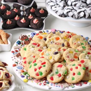 gumdrop cookies on a Christmas cookie platter surrounded by chocolate kiss cookies, crinkle cookies, and more