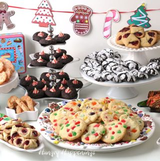 Display of cookies arranged on platters and cake stands for a Christmas Cookie Exchange.