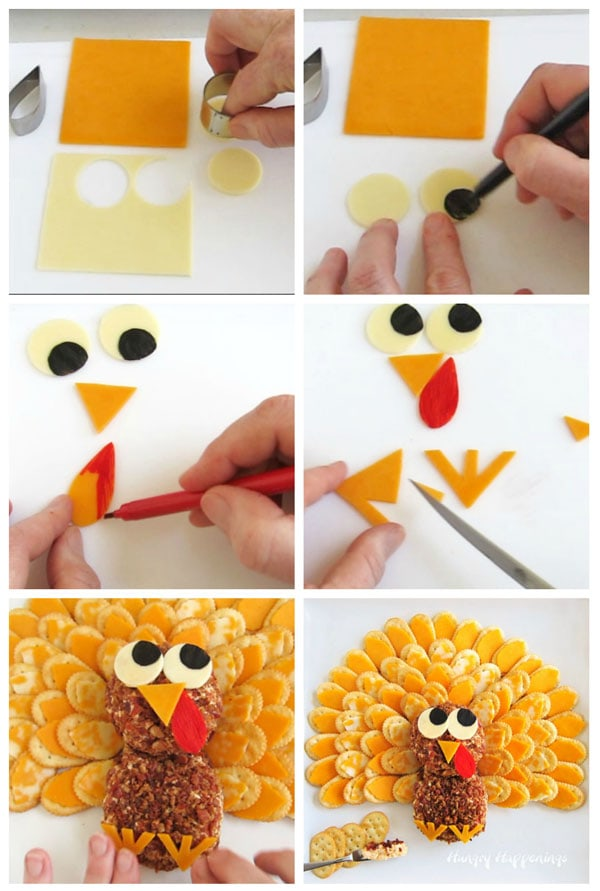 cut the white cheddar cheese eyes and draw on black food coloring pupils then cut an orange beak and wattle and color the wattle red, cut two orange cheddar cheese feet, then decorate the turkey cheese ball