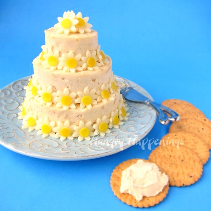 wedding cake cheese ball decorated with yellow daisies