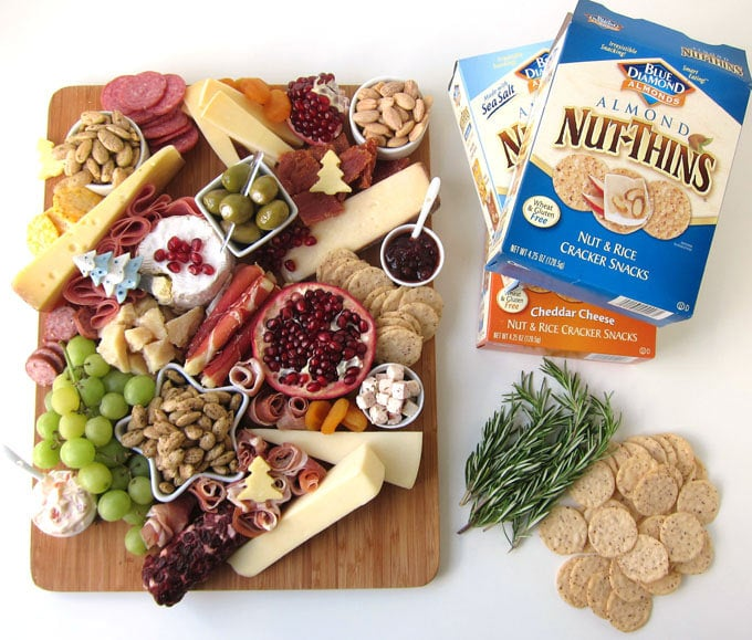 Boxes of Blue Diamond Nut-Thins surround the charcuterie board.
