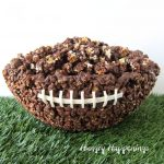 Chocolate Popcorn Bowl Football set on astro turf on a white background.