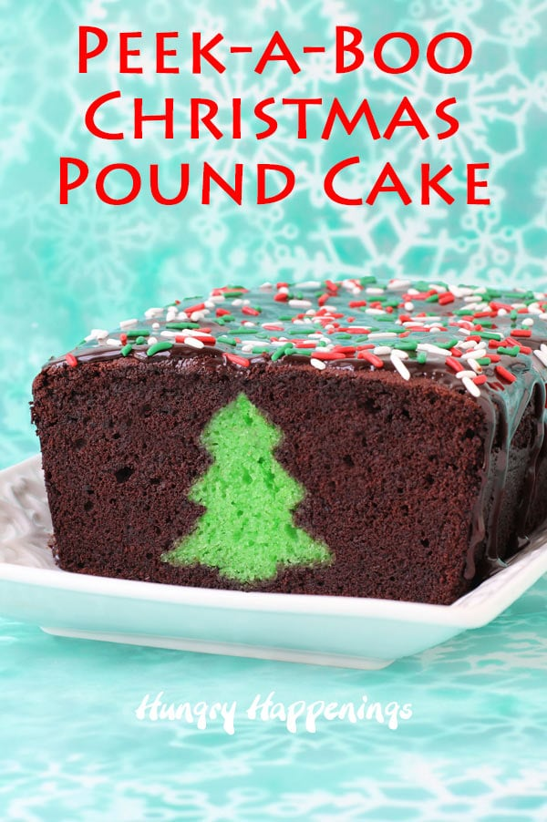 A chocolate thin mint Peek-a-Boo pound cake with chocolate glaze and red, white, and green sprinkles is on a white plate set on a green snowflake backdrop.