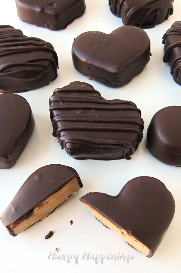Peanut butter fudge heats dipped in dark chocolate for Valentine's Day
