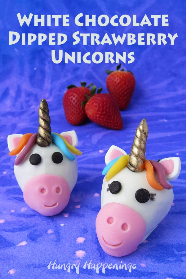 White chocolate dipped strawberry unicorns are decorated using modeling chocolate in a rainbow of colors.
