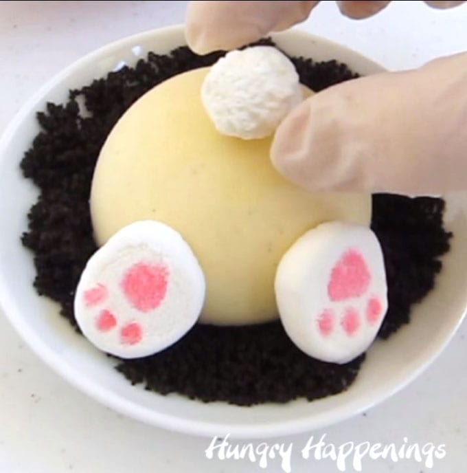 adding a marshmallow tail to a bunny butt cheesecake