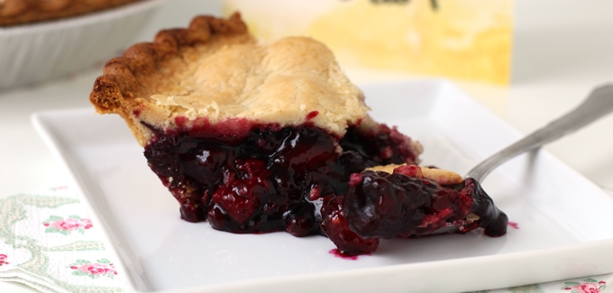 a slice of Wildberry Pie with lemon crust